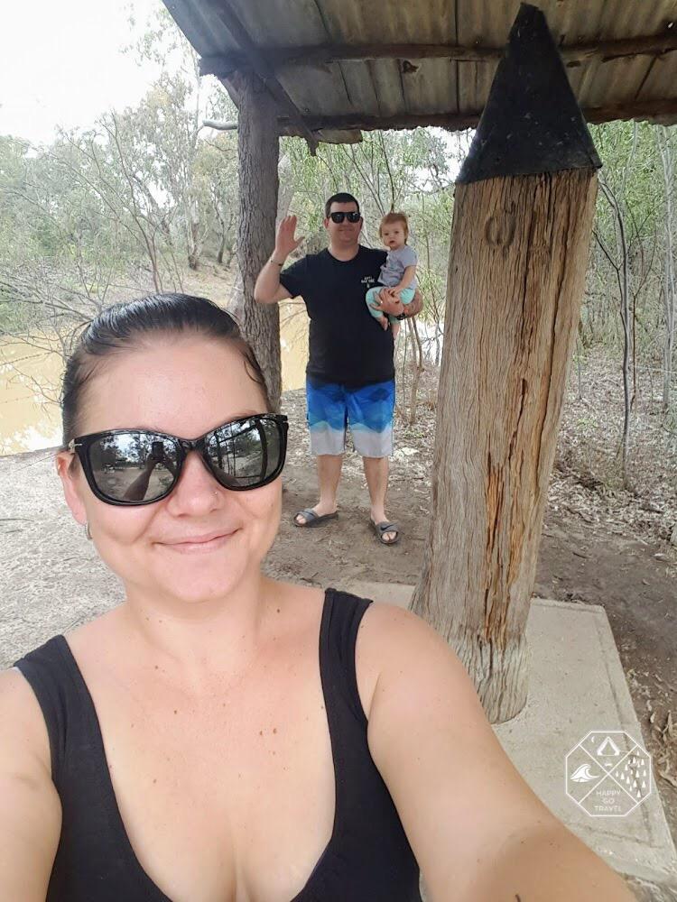 family at one ton post at Mungindi | QLD NSW border