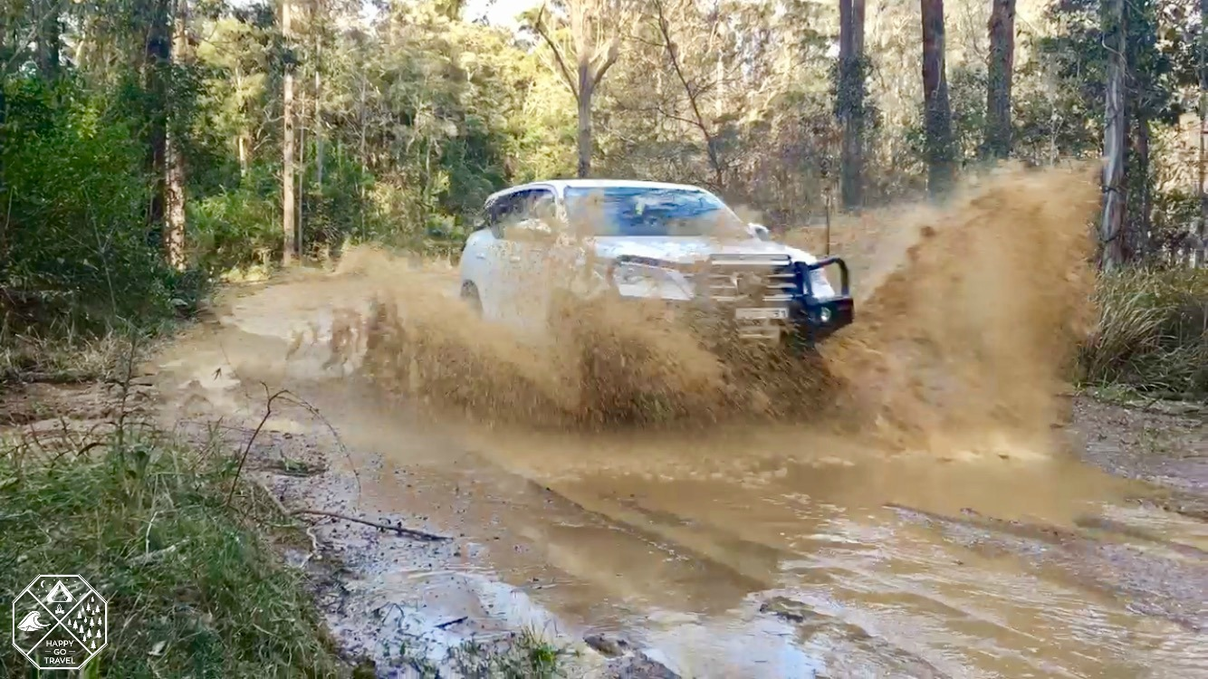 Toyota Fortuner CPT 80 road going through big puddle at entrance