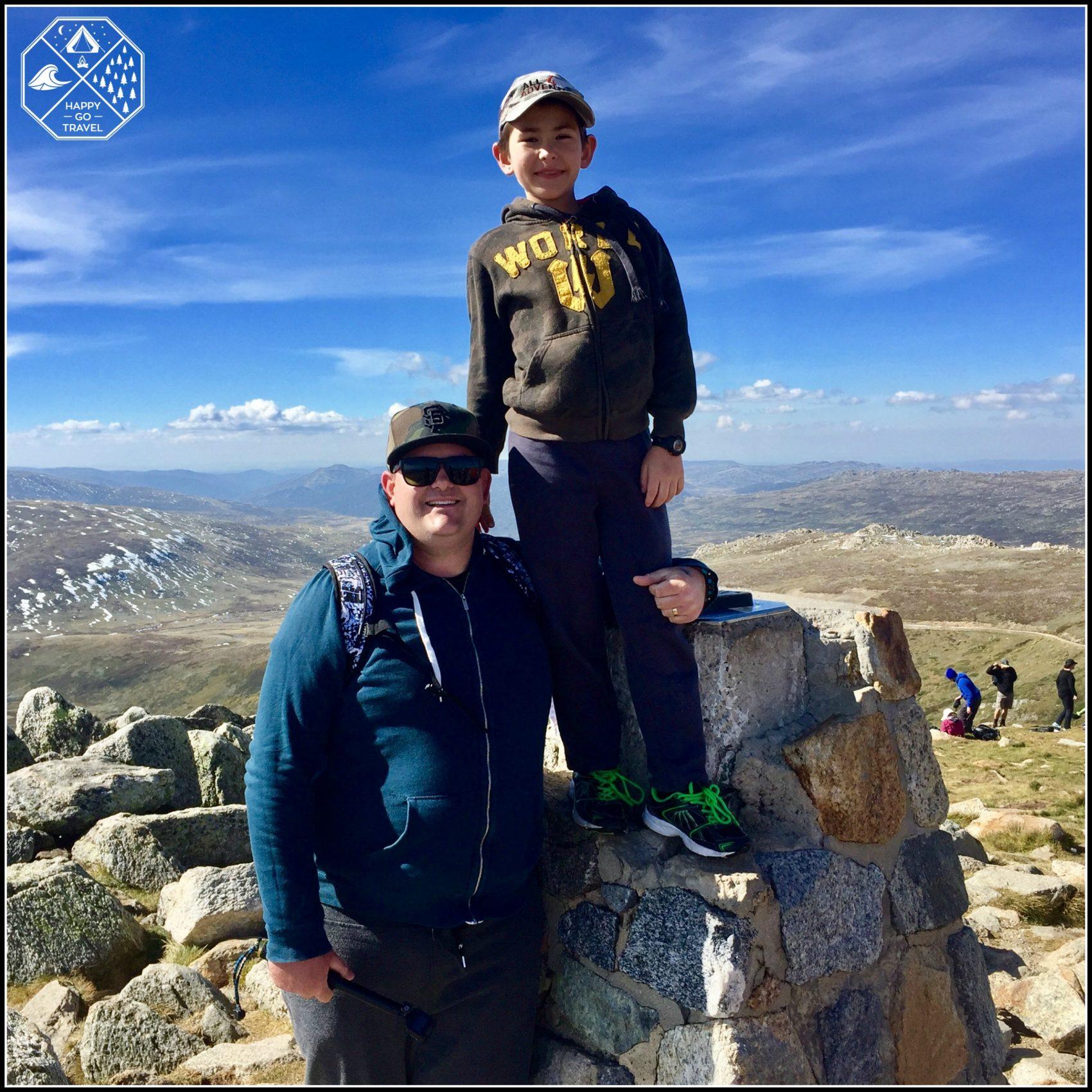 Happy Go Travel Caleb Dec at the sumit of Mt Kosciuszko