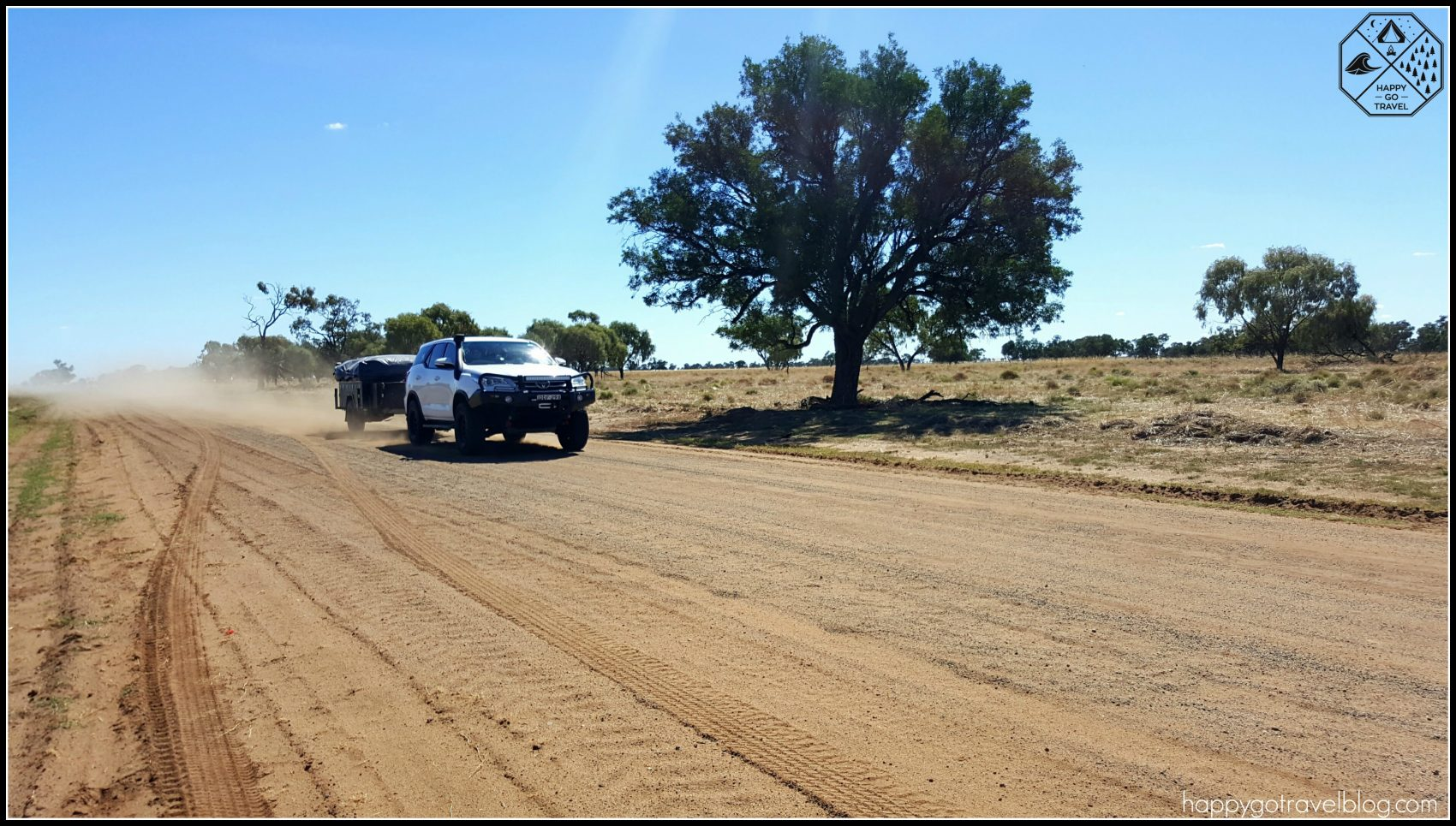 Toyota Fortuner driving on dirt road to Lightning Ridge with camper trailer