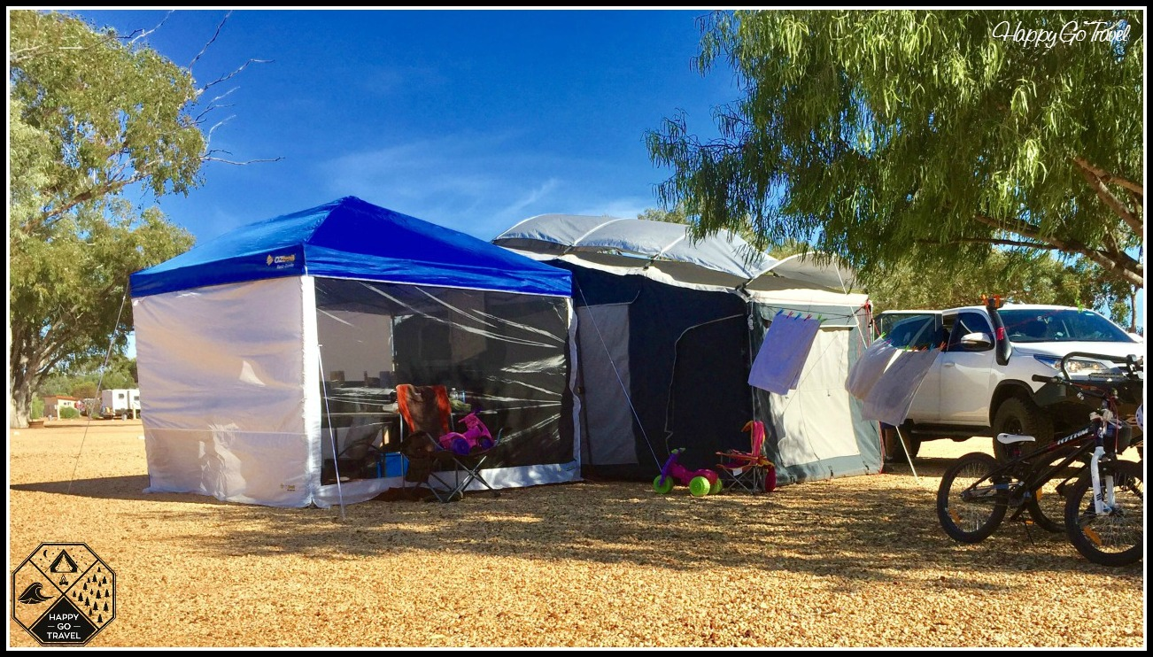 Black Series camper trailer setup with OZtrail Fiesta gazebo