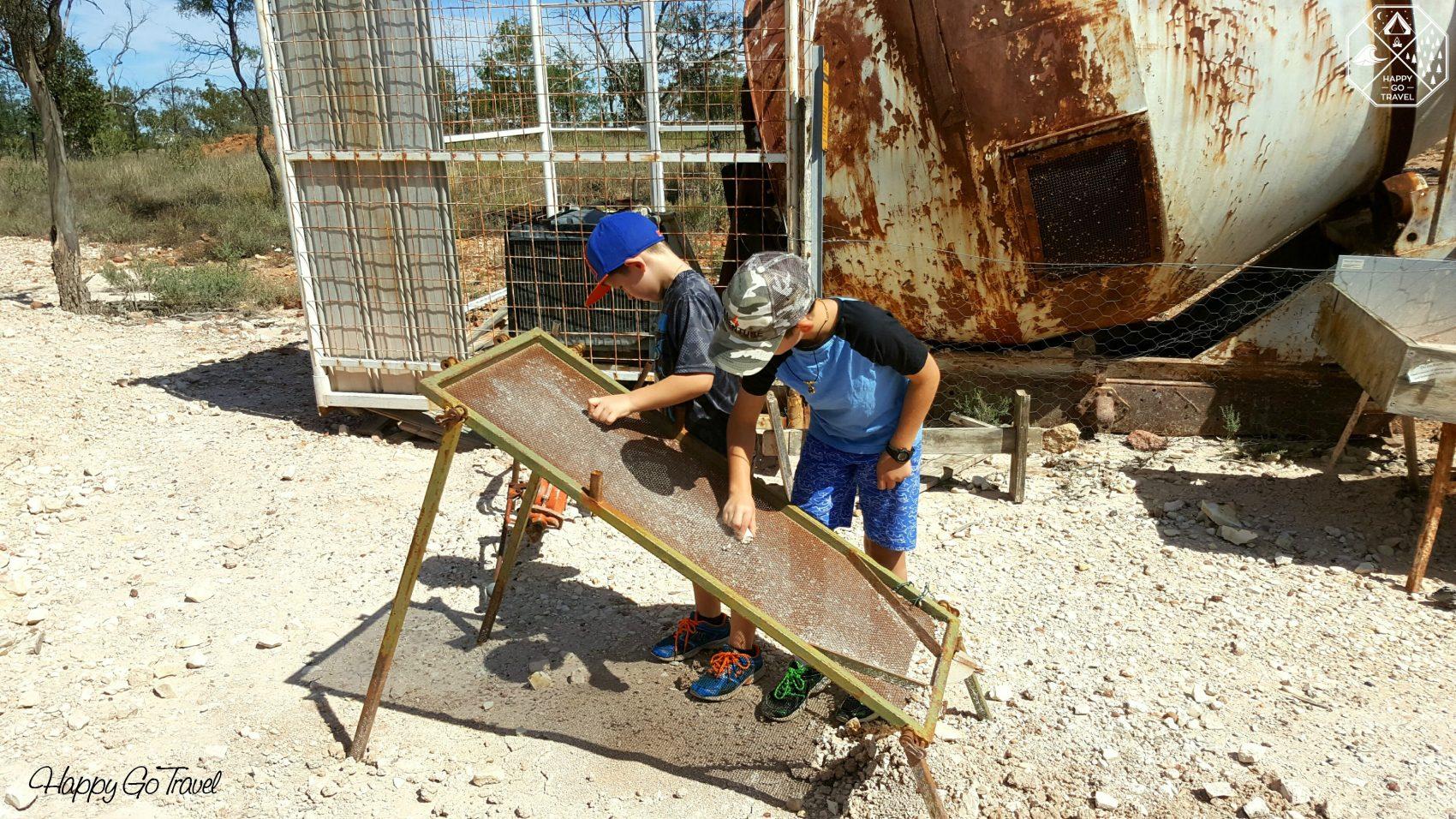Boys fossicking for opals at Lightning Ridge   Lightning Ridge opal mines
