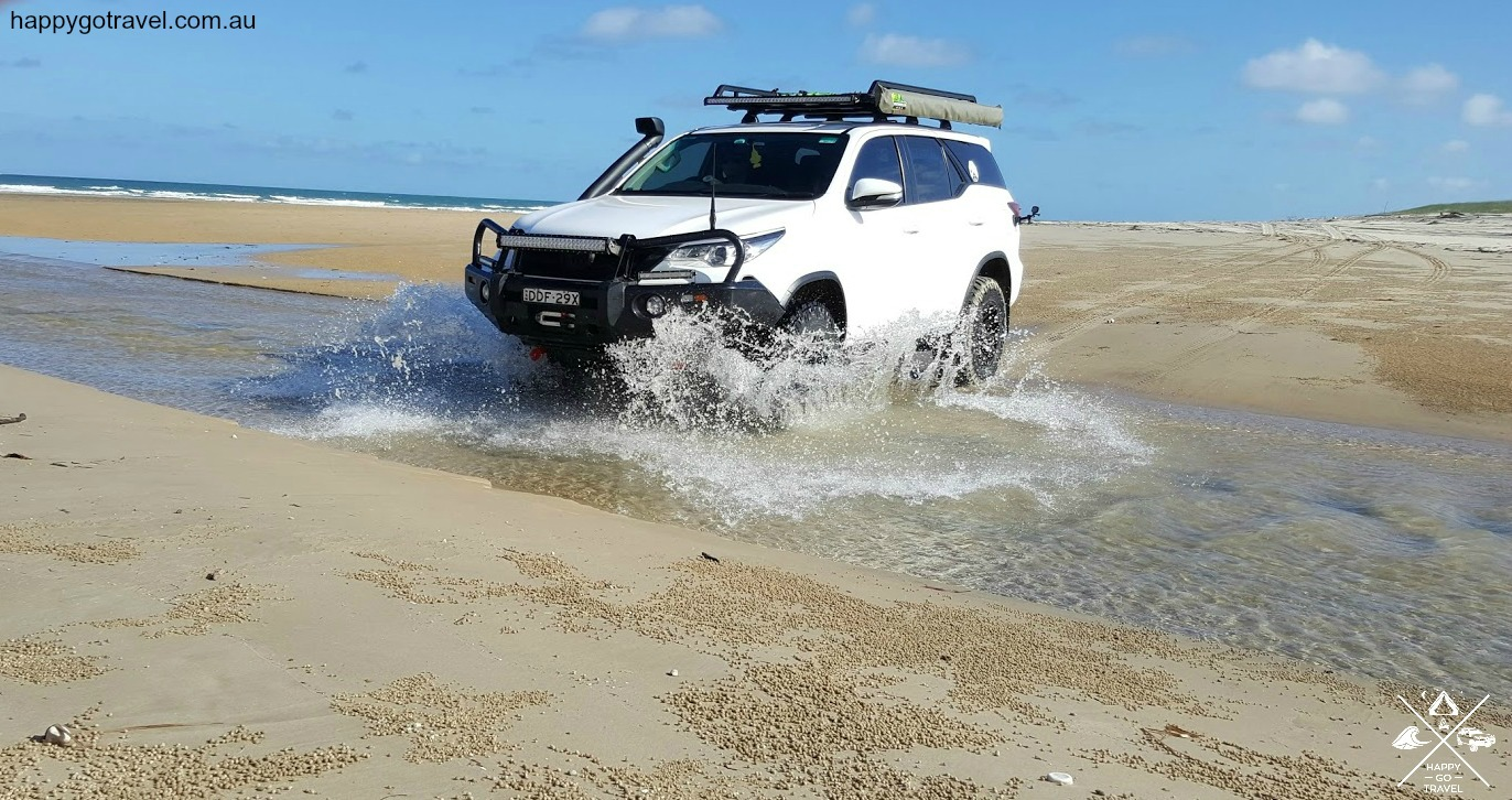 Toyota Fortuner with Steinbauer power module, crossing river 9 Mile Beach, Byfield National park Queensland