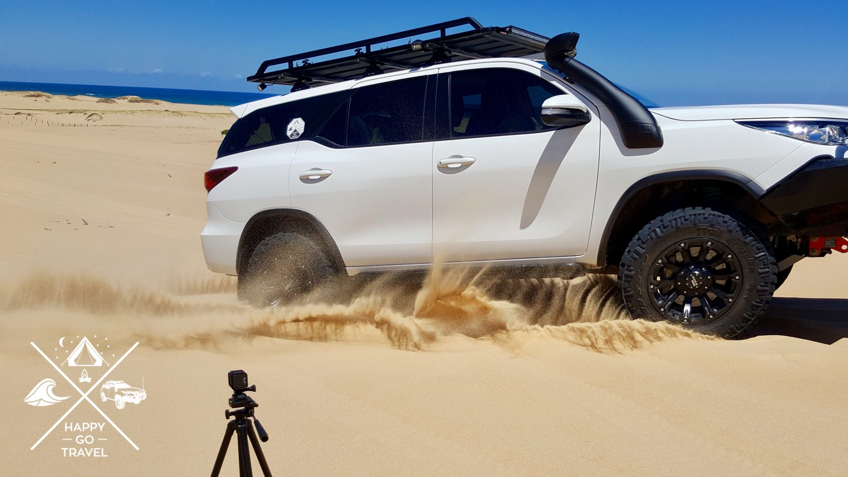 toyota fortuner on beach with roof rack