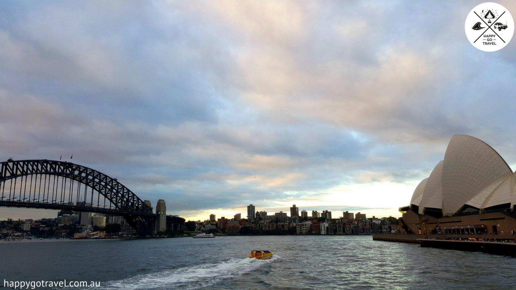 Sydney harbour with both the Sydney harbour bridge and sydney opera house