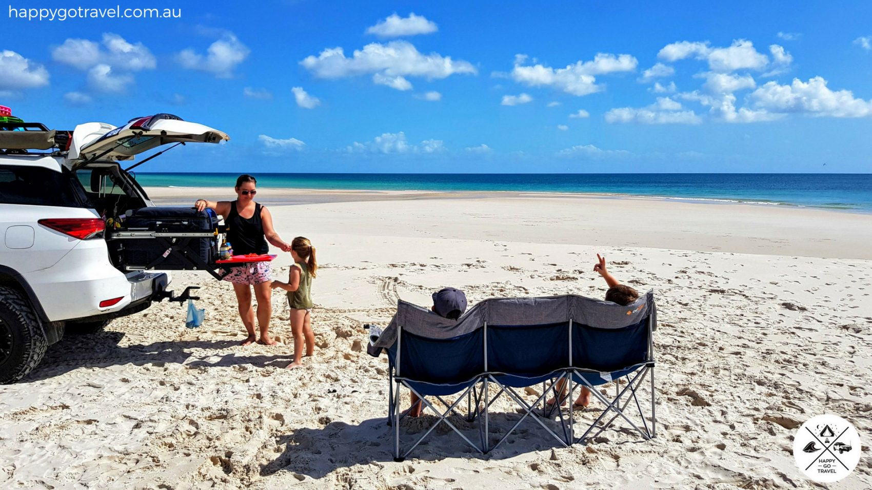 OZtrail 3 seater galaxy seat on Fraser Island with family