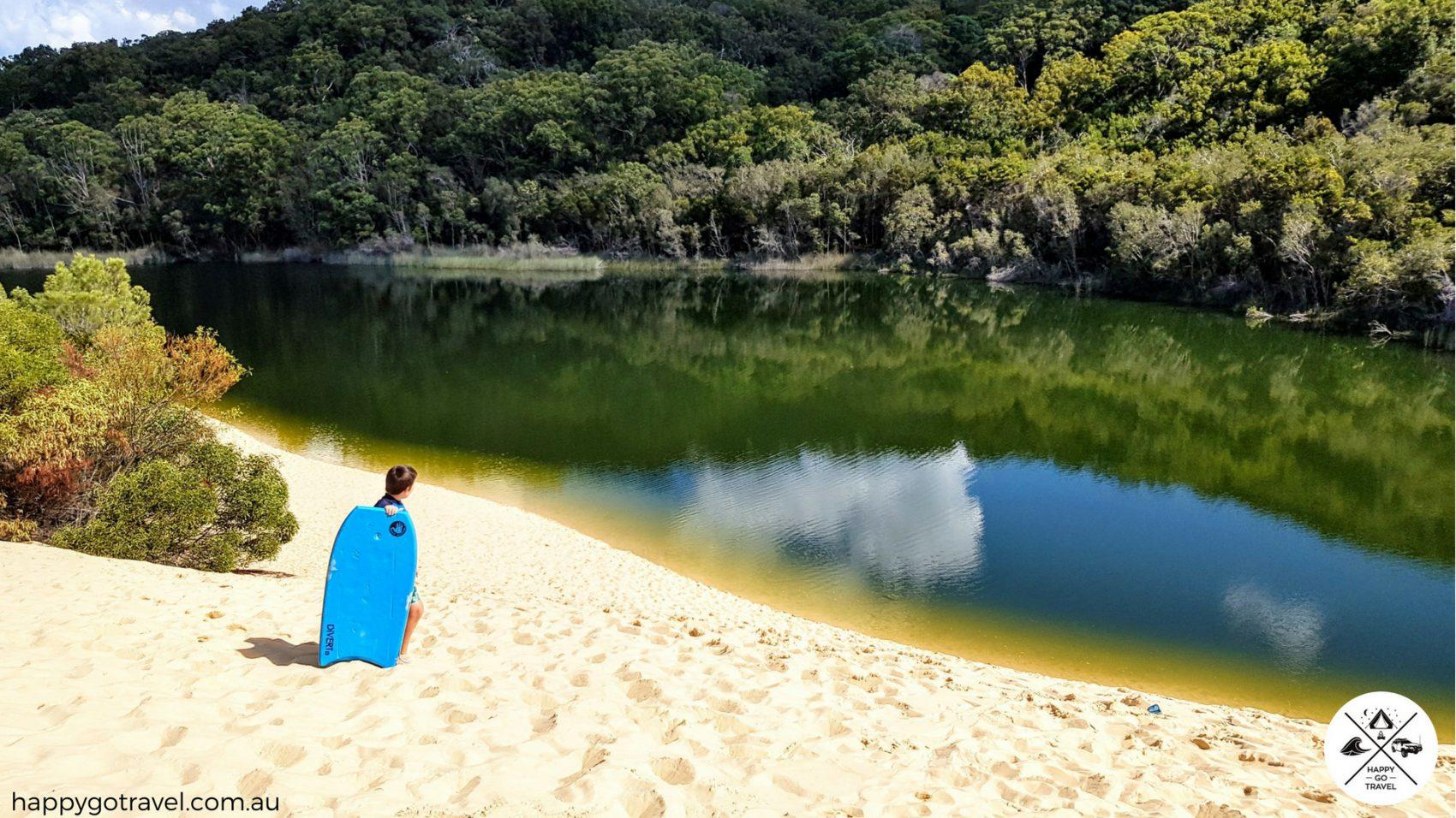 Kids sliding down dune lake wabby Fraser Island