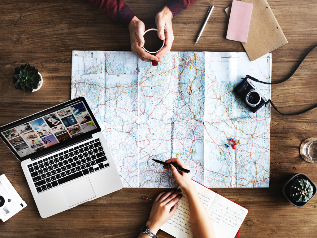 world map and laptop travel tips