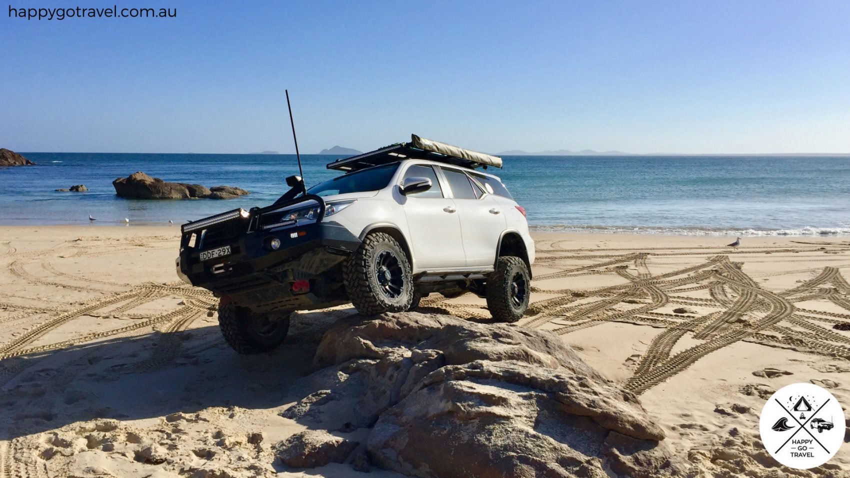 Toyota Fortuner Nolathane upper control arms. suspension flex on a rock at the beach